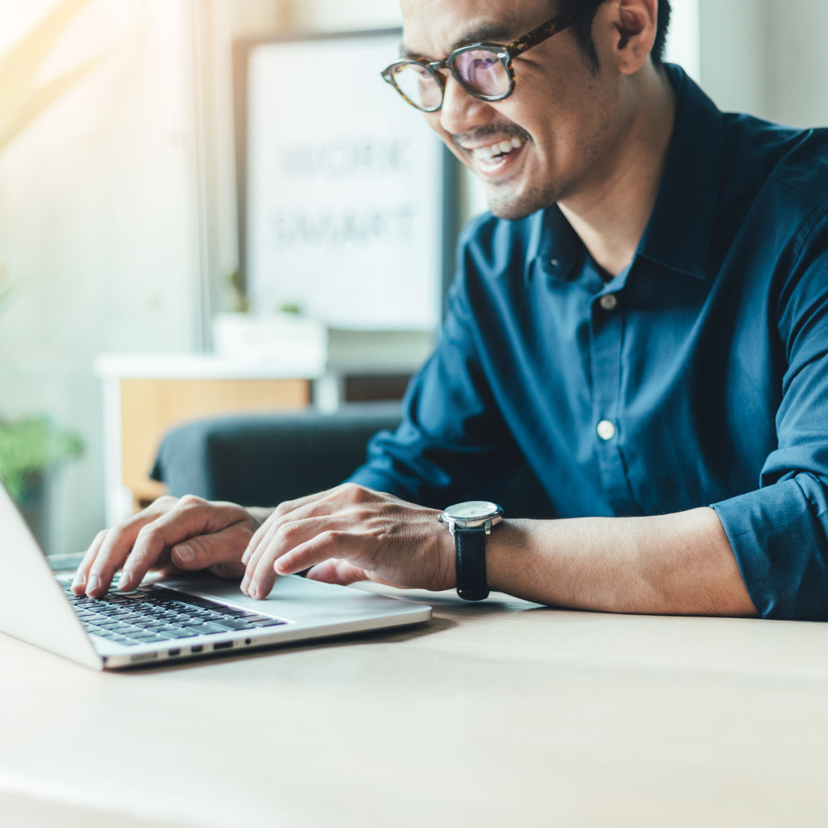 man using computer and happy
